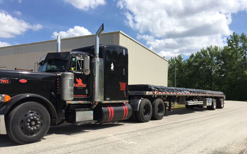 Flatbed - results in tremendous weight savings, allowing us to maximize the weight capacity on tandem axles at Falcon Xpress.