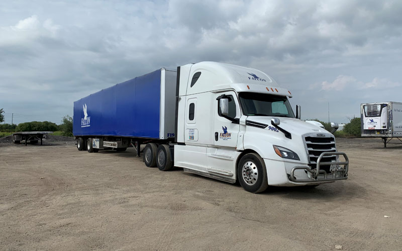 Roll-Tite Equipment - This allows us to haul shipments up to 102″ wide and tall at Falcon Xpress.